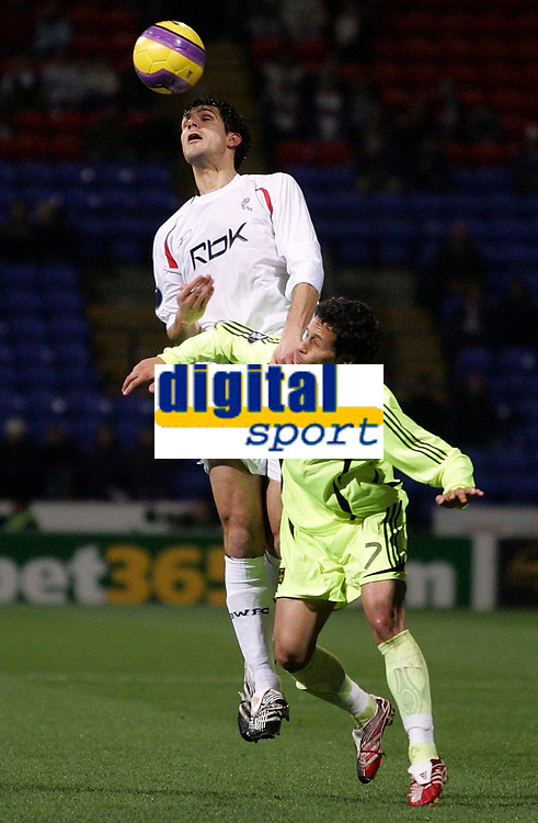 Photo: Paul Thomas/Sportsbeat Images.<br /> Bolton Wanderers v Aris Salonica. UEFA Cup. 29/11/2007.<br /> <br /> Gerald Cid of Bolton wins the ball from Antonio Kalvo Arandes (R).