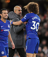 Football - 2018 / 2019 Premier League - Chelsea vs. Manchester City<br /> <br /> Man City Manager comes onto the pitch at the final whistle to congratulate Chelsea goalscorer, David Luiz a hug, at Stamford Bridge.<br /> <br /> COLORSPORT/ANDREW COWIE
