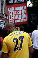 Abul Koyair, one of the brothers arrested mistakenly in east london 'terrorism' raid wearing Menezes football shirt to recognise the first anniversary of the mistaken shooting of Jean-Charles De Menezes, at the Anti-war march, 22nd July, 2006, london, UK