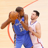11 May 2014: Los Angeles Clippers guard J.J. Redick (4) defends on Oklahoma City Thunder forward Kevin Durant (35) during the Los Angeles Clippers 101-99 victory over the Oklahoma City Thunder, during Game Four of the Western Conference Semifinals of the NBA Playoffs, at the Staples Center, Los Angeles, California, USA.