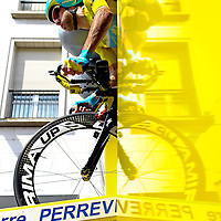 France, Bergerac, 26-07-2014.<br /> Cycling, Tour de France.<br /> Stage: Time Trial of 54 km from Bergerac to Perigueux.<br /> Vincenzo Nibali, wearing the leader's Yellow Jersey, is leaving the start ramp with full power.<br /> Photo: Klaas Jan van der Weij