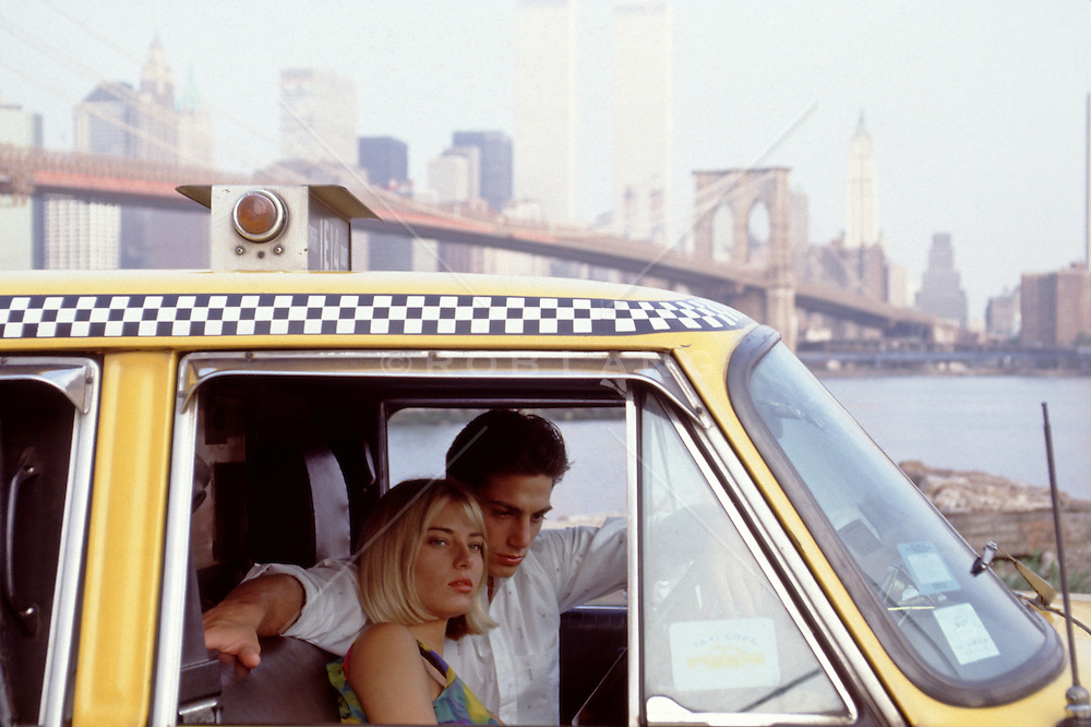 couple sitting in a taxi overlooking New York City before 9/11