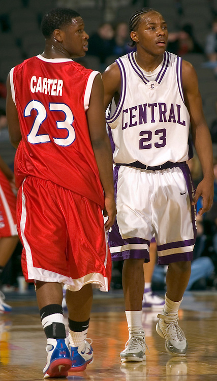 """2/11/06 -- Omaha, Ne.Reserve Christian's Demond """"Tweety"""" Carter  and Omaha Central's Josh Jones  at The Omaha Shootout, a High School Basketball tournament featuring some of the best prospects at the Qwest Center Omaha...(Photo by Chris Machian/Prarie Pixel Group)."""