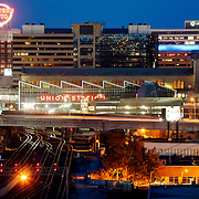 Kansas City at dusk. Railroads, Union Station, Western Auto Lofts Building.