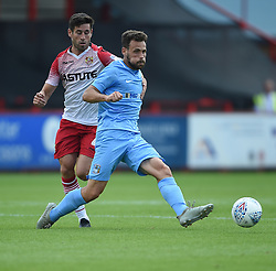 Coventry City's Toni Andreu and Stevenage's Alex Revell