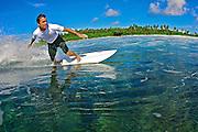 Scott Clephane surfing in the Maldives