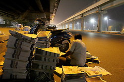April 27, 2018 - Delhi, India - Distributors sort through Newspapers before selling them during early hours in Gurgaon, Haryana, on April 28, 2018. (Credit Image: © Nasir Kachroo/NurPhoto via ZUMA Press)