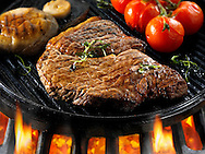 Beef rump steaks & tomatoes being pan fried  on a bbq. Meat food photos, pictures & images.