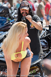 """Kristi Verhoff poses with Gilby's Street Dept. """"Green Onion"""" custom at the 27th Annual Boardwalk Bike Show during Daytona Bike Week 75th Anniversary event. FL, USA. Friday March 11, 2016.  Photography ©2016 Michael Lichter."""
