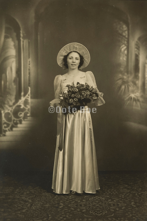 Formal photograph of a bride by her self.