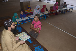 June 13, 2017 - Lahore, Punjab, Pakistan - Pakistani faithful Muslims children recite the Holy Quran during the Holy month of Ramadan-ul-Mubarak at a local mosque. Each year Muslims spend the ninth month of the Islamic calendar observing a community-wide fast. (Credit Image: © Rana Sajid Hussain/Pacific Press via ZUMA Wire)