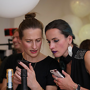 London,England,UK, 11th Aug 2016 : Zuzana and Zuzana both a blogger attend the wine retailer hosts summer party to sample its award-winning sparkling wine range at Icetank Studios, Lo0ndon,UK. Photo by See Li