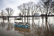 flood of the Rhine on February 5th. 2021, flooded tennis courts and trees in the water in the district Poll, Cologne, Germany.<br /> <br /> Hochwasser des Rhein am 5. Februar 2021, ueberflutete Tennisplaetze und Baeume im Wasser, Rheinufer in Poll, Koeln, Deutschland.