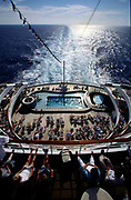 The view from the bow of the P&O liner Oriana showing passengers sunbathing on deck and the ocean