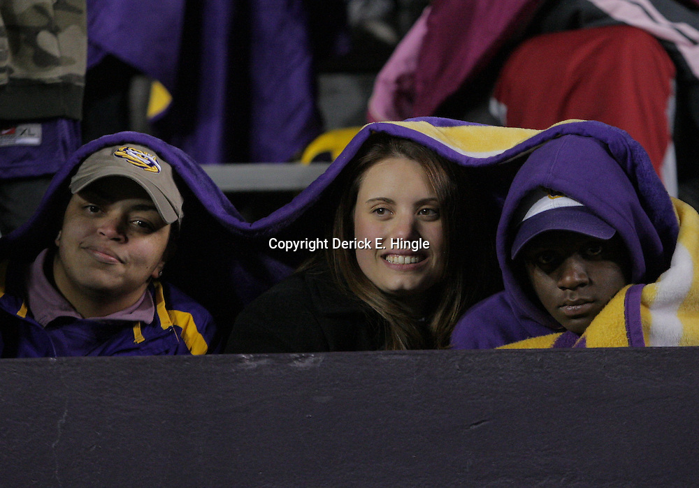 15 November 2008: LSU fans share a blanket in the stands during the LSU Tigers 40-31 come from behind victory over the Troy Trojans at Tiger Stadium in Baton Rouge, LA.
