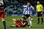 Grant Hall (QPR) slide tackles Aiden McGeady (Sheffield Wednesday) during the Sky Bet Championship match between Sheffield Wednesday and Queens Park Rangers at Hillsborough, Sheffield, England on 23 February 2016. Photo by Mark P Doherty.