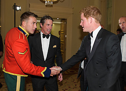 L/Cpl Nick Webb, Royal Dragoon Guards, Justin Packshaw, North Pole Adventurer with Prince Harry.<br /> Prince Harry, Patron of the Walking With The Wounded South Pole Allied Challenge, attends the charity's Crystal Ball at the Grosvenor House Hotel, central London.<br /> The event hosted by Ben Fogle, with music Ellie Goulding and The Stereophonics. Also present were Olympian Matthew Pinsent CBE and Team Glenfiddich. The team of wounded service personnel will accompany the Prince on an expedition to the South Pole later this year, London,<br /> Thursday, 30th May 2013<br /> Picture by Anthony Upton / i-Images