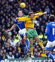 Photo: Chris Ratcliffe.<br /> Norwich City v Ipswich Town. Coca Cola Championship. 05/02/2006.<br /> Jason De Vos of Ipswich goes up for a header with Jonatan Johansson of Norwich