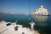 Fishermen in front of the Museum of Islamic Art designed by American star architect I.M. Pei.