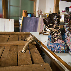 Boots with paint covering them.