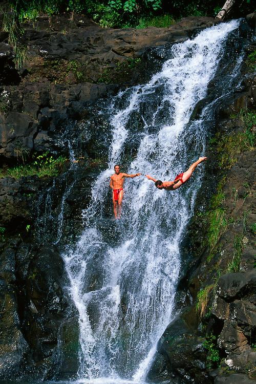Acrobatic cliff diving, 45 foot Waimea Falls, Waimea Falls Park, Waimea Bay, North Shore, Oahu, Hawaii