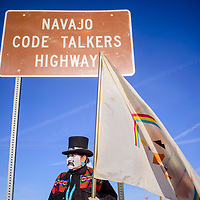 032415       Cable Hoover<br /> <br /> Nicole Walker stands by the Navajo Code Talkers Highway sign in Yatahey as she prepares to start her hike to Window Rock Tuesday.