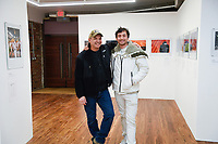 3/7/19 10:14:57 PM -- New York, NY  --  Jack Gruber and Ki Smith at the KI SMITH GALLERY BENEFIT AUCTION FOR BOYD'S STATION --<br /> <br /> Witness: Beauty in the Truth<br /> <br /> FORTY AWARD-WINNING PHOTOJOURNALISTS WORK BENEFITTING THE NONPROFIT BOYD'S STATION<br /> <br /> Captured by some of today's most acclaimed photojournalists, this impressive collection of photographs depicts some of the most famous moments in recent history. These iconic images have circulated the globe in internationally-respected publications, but are rarely available to the public as authenticated, museum quality prints. <br /> <br /> The Ki Smith Gallery Benefit Print Auction for Boyd's Station opens with a public reception on Thursday, March 7, 2019 at 6PM-10PM showcasing over 70 large prints displayed and made available for this special silent auction benefit.  --    Photo by Jack Gruber, Boyd's Station