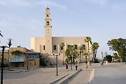 Israel, renovated old city of Jaffa now an artist's colony, Kikar Kdumim (Kdumim Square) centre of Old Jaffa Steeple of St Peter's church and Monastery in the background