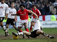 Photo: Paul Thomas. Nottingham Forest v Derby County. Forest Ground, Nottingham. Coca Cola Championship. 26/02/2005. Forest's david Johnson is tackled by Muhamed Konjic.