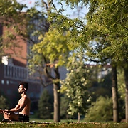 Jovi Taylor, an independent practice life coach, meditated in the sunlight at Mill Creek Park as a part of his physical workout at the park following the late morning rains that moved through the Kansas City metro area.