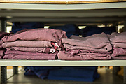 Folded prison issue jumpers ready for distribution in the prison laundry. <br /> HMP/YOI Portland, a resettlement prison with a capacity for 530 prisoners. Dorset, United Kingdom.