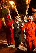 Children walking with burning torches made of straw, Nozawaonsen, Japan