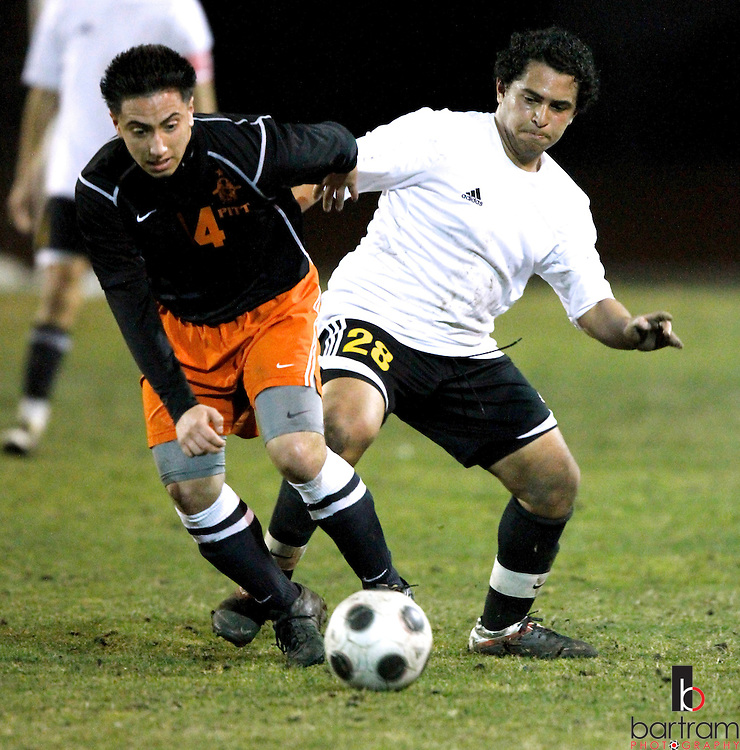 Antioch High's Rene Gonsalez, right, and Pittsburg High's Ismael Martinez fight for the ball during their game at Antioch High School on Tuesday, Feb. 7, 2012. (Photo by Kevin Bartram)