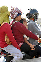 Four Family Members on One Moped in Phnom Penh, Cambodia