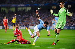 Man City Midfielder Jesus Navas (ESP) is challenged by Bayern Midfielder David Alaba (AUT) during the first half of the match - Photo mandatory by-line: Rogan Thomson/JMP - Tel: Mobile: 07966 386802 - 02/10/2013 - SPORT - FOOTBALL - Etihad Stadium, Manchester - Manchester City v Bayern Munich - UEFA Champions League Group D.