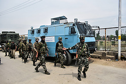 May 5, 2018 - Srinagar, J&K, India - Indian paramilitary troppers arrive near the encounter site in Srinagar, Indian administered Kashmir. Three suspected militants and one civilian have been killed while three Indian paramilitary men sustained injuries in a gun battle in Srinagar, the summer capital of Indian administered Kashmir.  The encounter started after government forces cordoned off a Chattabal area following the presence of militants in the area, officials said.  More than 2 houses were damaged in the gun battle where the militants were believed to be trapped. The separatists have called for a shutdown on Sunday against the killings. (Credit Image: © Saqib Majeed/SOPA Images via ZUMA Wire)