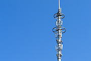Stacked GSM and CDMA cellsite base station antenna array for the cellular telephone system on a pole tower - Nanjing, China <br /> <br /> Editions:- Open Edition Print / Stock Image