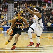 Skylar Diggins, (left), Tulsa Shock, drives past Alex Bentley, Connecticut Sun, during the Connecticut Sun Vs Tulsa Shock WNBA regular season game at Mohegan Sun Arena, Uncasville, Connecticut, USA. 3rd July 2014. Photo Tim Clayton
