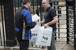 © Licensed to London News Pictures. 14/07/2016. London, UK. Bags bearing the words 'for better communication - you need EARS' are delivered to the back of Downing Street as Prime Minister Theresa May continues to make cabinet appointments on her first full day in office. Photo credit: Peter Macdiarmid/LNP