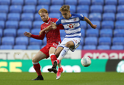 Gillingham's Connor Ogilvie (left) and Reading's Sam Smith battle for the ball during the Carabao Cup, first round match at the Madejski Stadium, Reading.