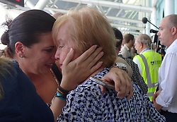 October 3, 2017 - Fort Lauderdale, Florida, U.S.- Families of Caribbean hurricane evacuees who arrived on board the Royal Caribbean Adventure of the Seas, greet their relatives, Tuesday, at Port Everglades. More than 3,000 people from Puerto Rico and the U.S. Virgin Islands were brought to Florida on board the cruise ship. (Credit Image: © Sun-Sentinel via ZUMA Wire)