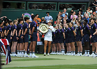 Lawn Tennis - 2021 All England Championships - Woman's Final - Wimbledon<br /> Ashleigh Barty v Karolina Pliskova<br /> <br /> Ashleigh Barty of Australia shows off her Winners Shield in front of all the Ball Boys and Girls<br /> <br /> <br /> Credit : COLORSPORT/Andrew Cowie