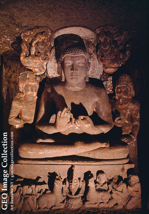 Buddhist monks began cutting Ajanta's caves into a curving gorge in the first c entury B.C.  The site was abandoned in the fifth century and was not rediscover ed until some 1400 years later, when the paintings within the caves influenced painting styles throughout Asia.  This is the Buddha in the antechamber of Cave No. 1.