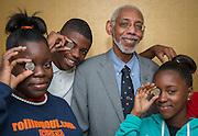 Dr. Ralph Ross poses for a photograph with some of his pre-calculus students at Yates High School, October 9, 2013.