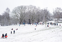 © Licensed to London News Pictures. 24/01/2021. London, UK. People sledging down a hill in Greenwich Park in southeast London after snow fell over the capital. Photo credit: Rob Pinney/LNP
