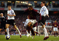 Photo: Olly Greenwood.<br />Arsenal v Liverpool. The Barclays Premiership. 12/03/2006. Arsenal's Thierry Henry bursts past Liverpool's Steve Finnan