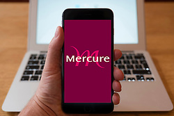 Using iPhone smartphone to display logo of Mercure hotel group