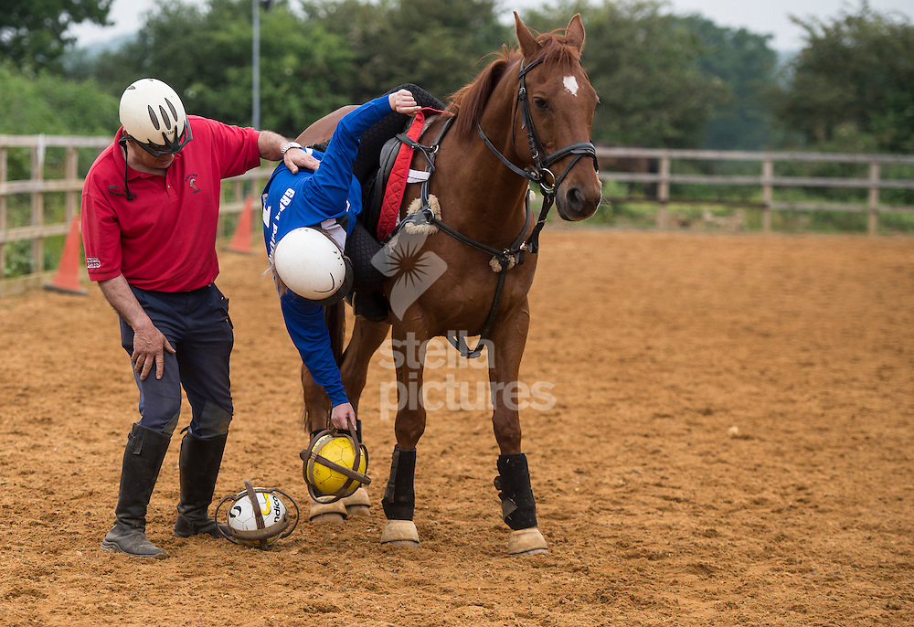 Daily Telegraph reporter Cristina Criddle get a little help as she takes part in horseball at Arkley Lane Stables, Barnet.<br /> Picture by Daniel Hambury/Stella Pictures Ltd +44 7813 022858<br /> 04/06/2016