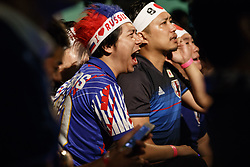 June 28, 2018 - Tokyo, Japan - Soccer fans react as they watch the FIFA World Cup Group H match between Poland and Japan at a public viewing event in the Star Rise Tower (Tokyo Tower Media Center) in Tokyo, Japan. Japan sealed their position to the second round of the FIFA World Cup despite losing to Poland 1-0 in Volgograd Arena in Volgograd, Russia. (Credit Image: © Rodrigo Reyes Marin/via ZUMA Wire via ZUMA Wire)