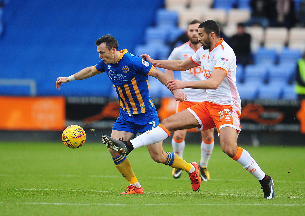Shrewsbury Town's Shaun Whalley under pressure from Blackpool's Colin Daniel<br /> <br /> Photographer Kevin Barnes/CameraSport<br /> <br /> The EFL Sky Bet League One - Shrewsbury Town v Blackpool - Saturday 16th December 2017 - New Meadow - Shrewsbury<br /> <br /> World Copyright © 2017 CameraSport. All rights reserved. 43 Linden Ave. Countesthorpe. Leicester. England. LE8 5PG - Tel: +44 (0) 116 277 4147 - admin@camerasport.com - www.camerasport.com